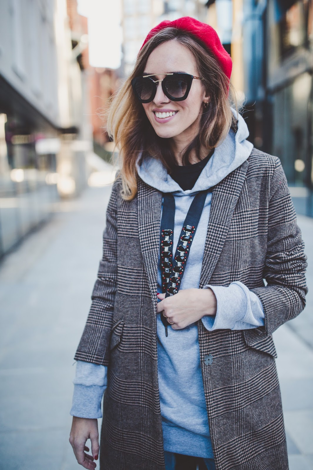 plaid print coat over hoodie