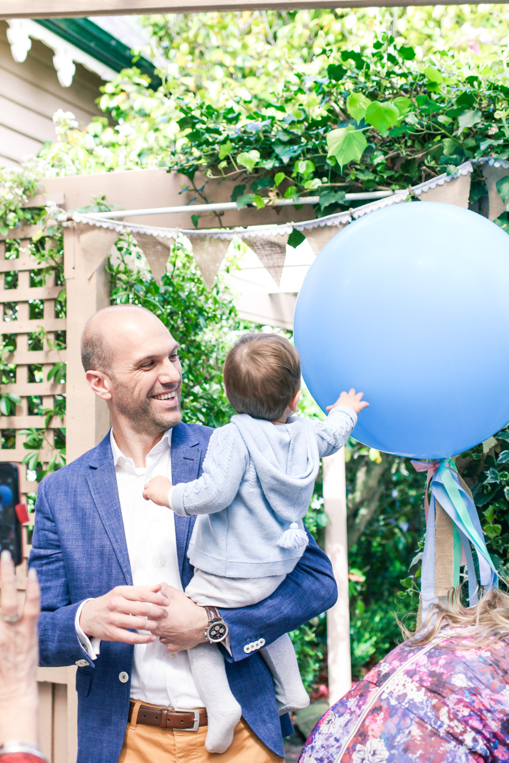 Giant blue balloon with ribbons and Peter Rabbit themed first birthday party