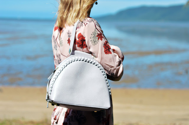 grey oliver bilou plaited statement handbag in front of summer ocean