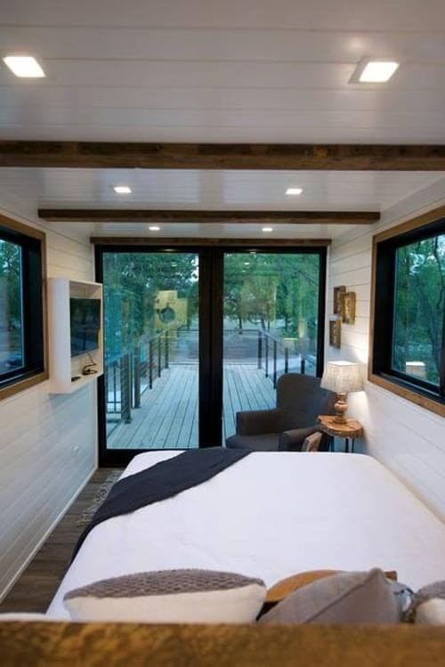 08-Master-Bedroom-Plus-Deck-Cargohome-Sustainable-Two-Story-Tiny-Home-Shipping-Containers-www-designstack-co