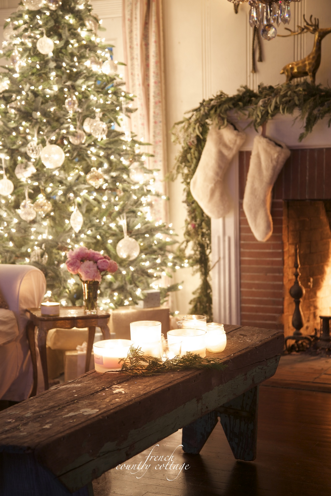christmas tree fireplace candles on bench in a living room - Decorating Living Room With Christmas Lights