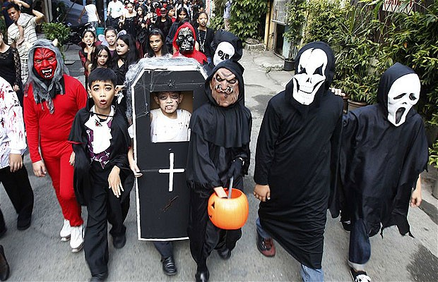 TRICK OR TREAT Pinoy students parade in their scary Halloween outfits. PHOTO CREDIT Reuters  sc 1 st  The Summit Express & Is it alright for Christians to celebrate Halloween? | The Summit ...