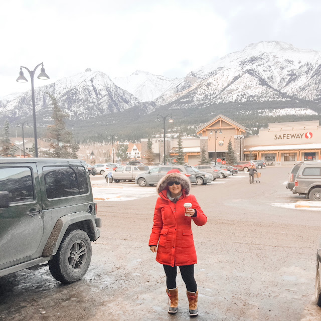 girl standing outside canmore starbucks