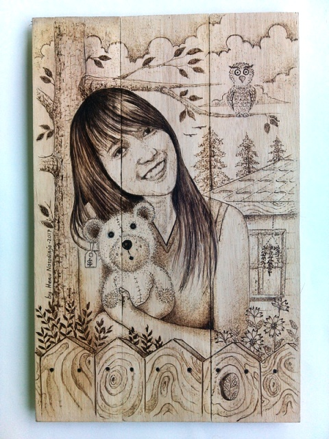 Lukisan Pirografi Semi Karikartur Andrea Putri Kinanti