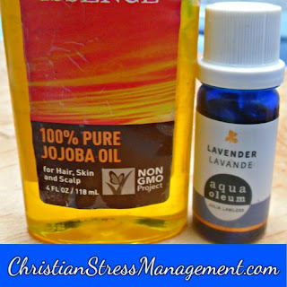 Lavender essential oil and jojoba carrier oil massage oil for stress management