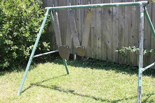 I cut down an old swingset frame for hanging steel targets and it works quite well.