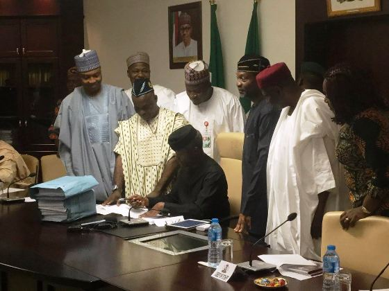 2 Acting President Yemi Osinbajo Signs The 2017 Budget Into Law (Photos)