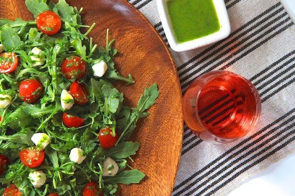 http://www.greensnchocolate.com/2014/06/arugula-caprese-salad-basil-vinaigrette/