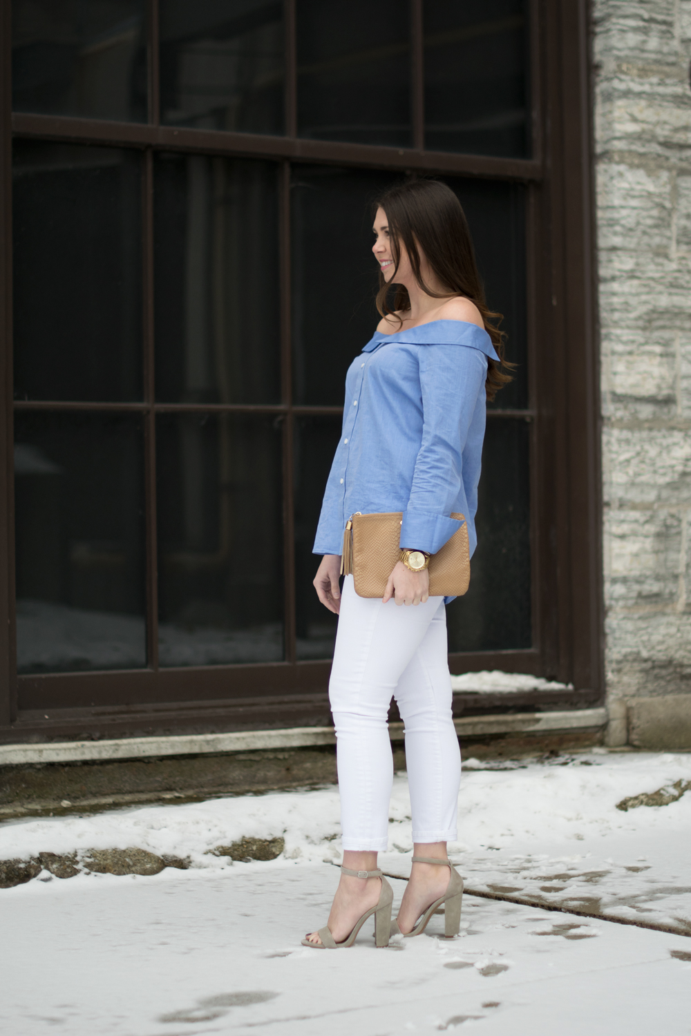 Blue and white outfit with neutral accessories.