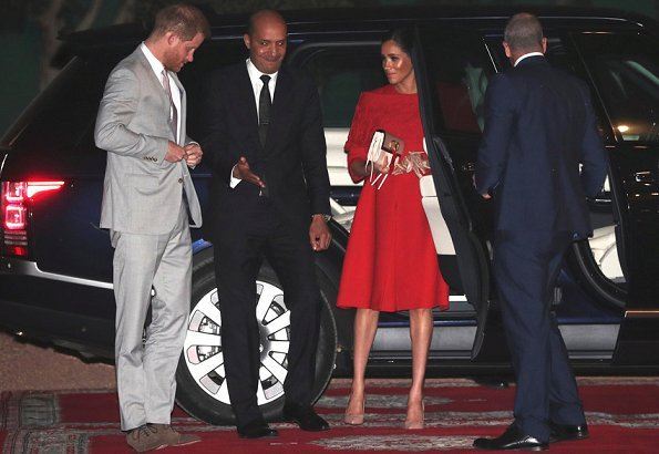 Meghan Markle wore bespoke Valentino dress with nude heels, gloves and a Valentino clutch bag