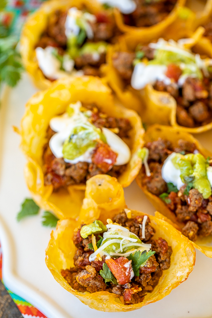 Low-Carb Keto Tacos - all the flavors of tacos without all the carbs! The shells are made out of cheese! OMG! YUM! Cheese, ground beef or turkey, taco seasoning, diced tomatoes and green chiles, and water. Ready to eat in minutes. Can make shells ahead of time for a quick weeknight meal. You'll never miss the carbs! #lowcarb #keto #tacos #mexicanfood #texmex