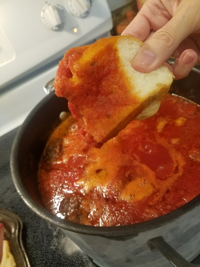 This is how to make Italian tomato sauce and dipping a piece of bread to taste if its seasoned correctly