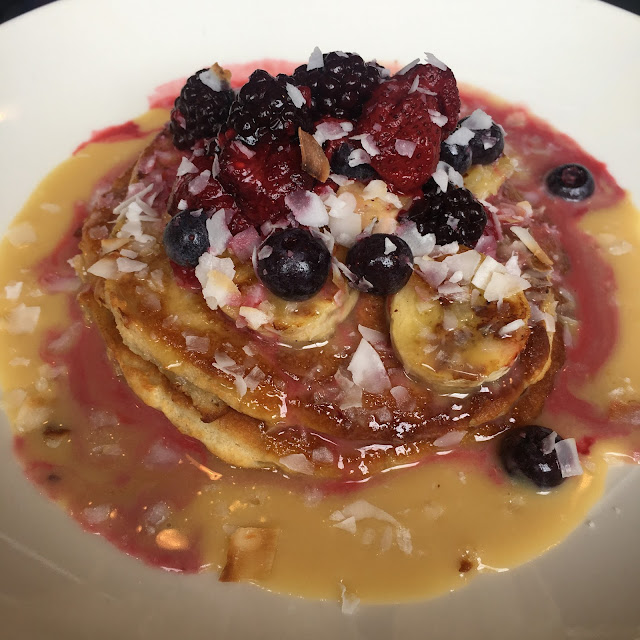 coconut pancakes with berries and caramelised bananas at little henri thornbury