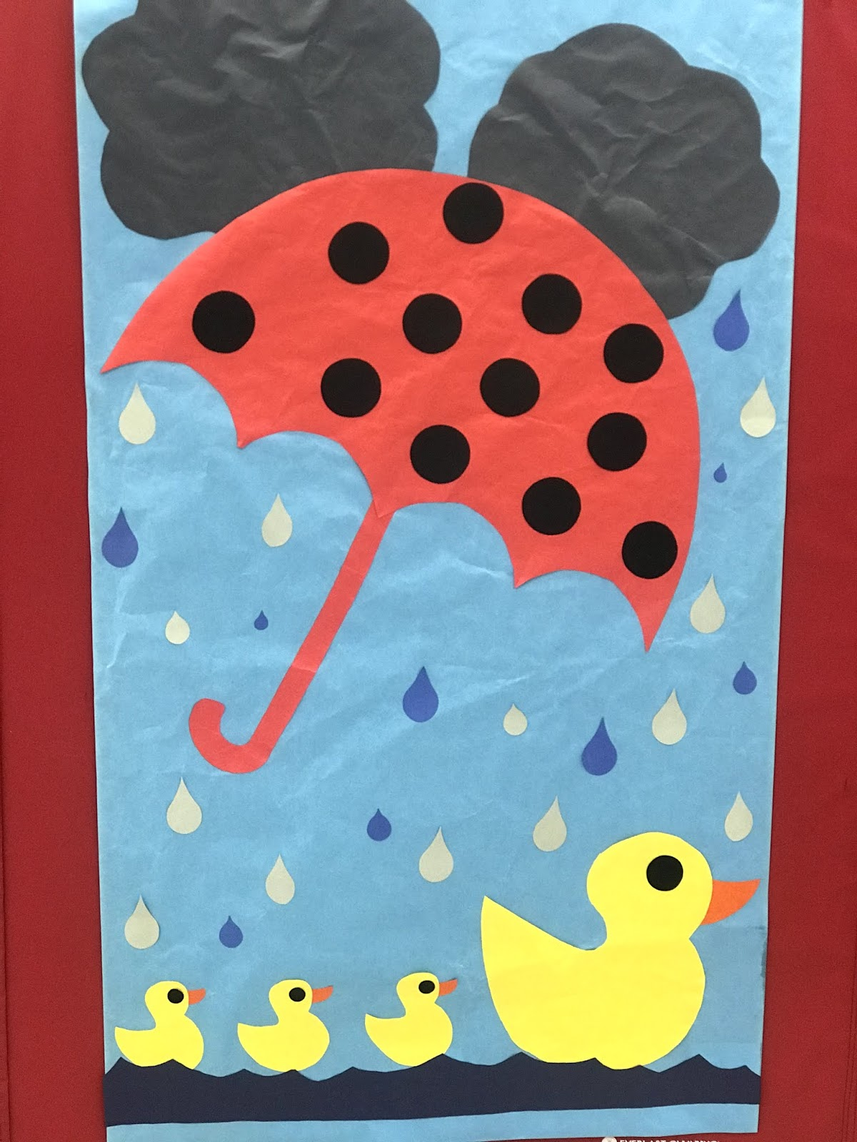 a long spring decoration of raindrops on a duck and baby ducks
