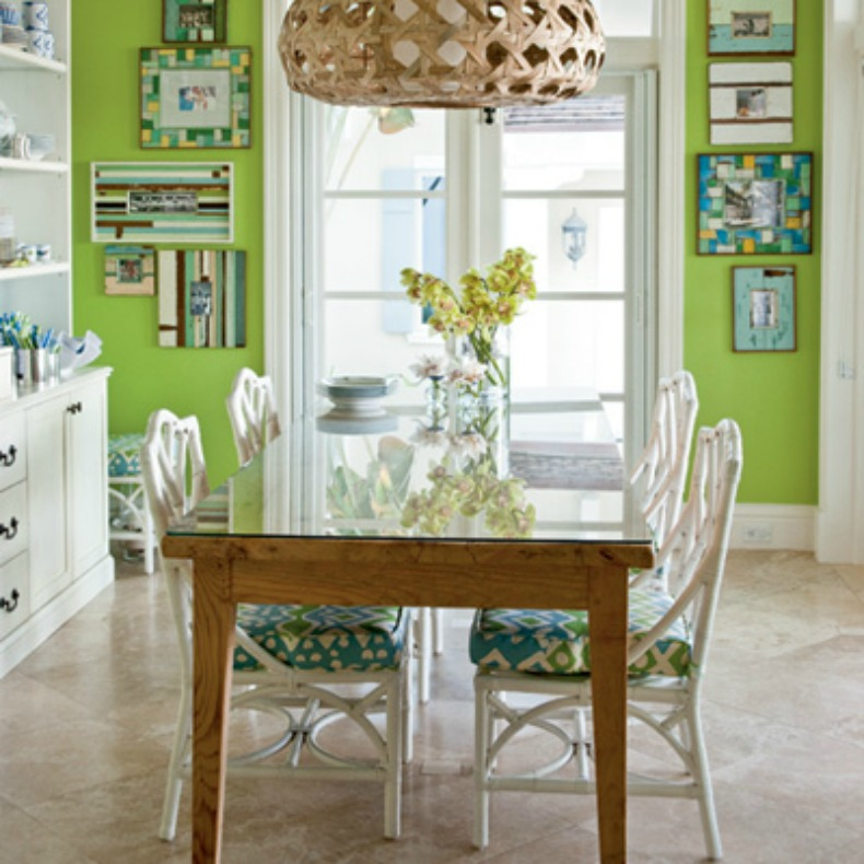 Green coastal breakfast room with rattan chandelier