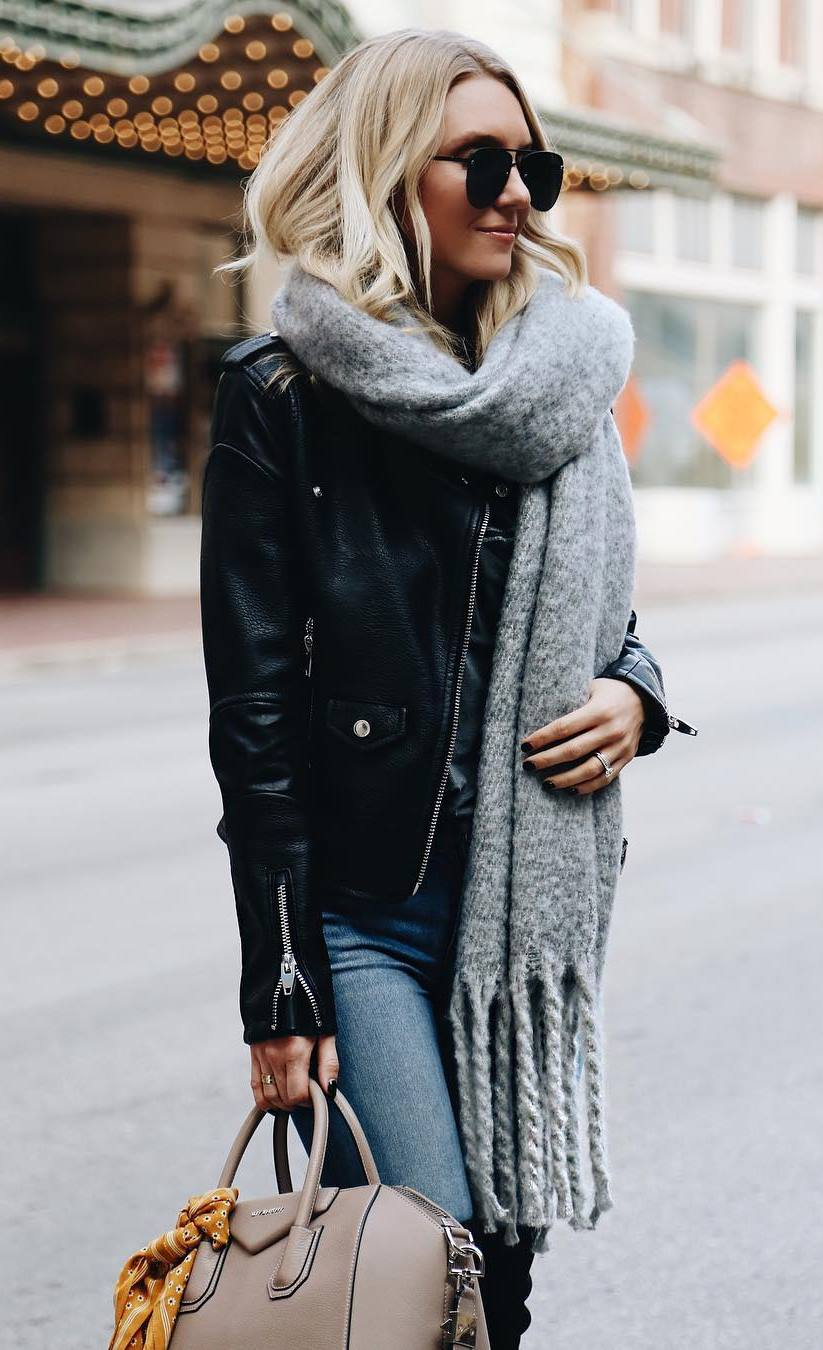what to wear with a scarf : moto jacket + jeans + beige bag + over knee boots