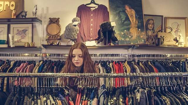 Woman browsing a cloths rack in a shop