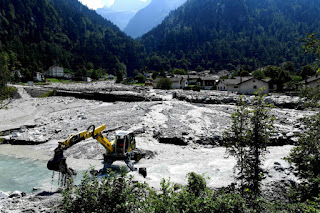 Storms have triggered landslides in the Alps that have sent mud and debris pouring into villages. Bondo, in the Swiss Alps, has been hit more than once in recent years. The video below shows the destruction from 2017. (Credit: Miguel Medina/AFP/Getty Images) Click to Enlarge.