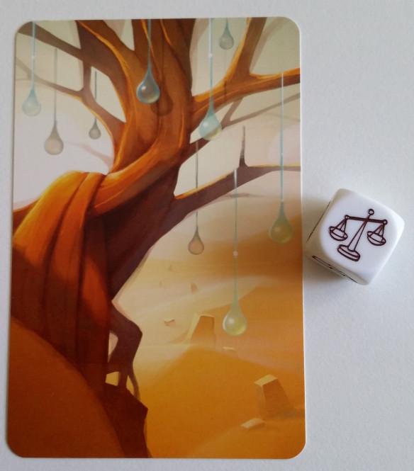 Carta de árbol y balanza en dado