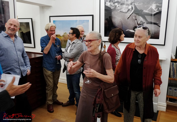 Guests mingle at Badger & Fox Gallery for the opening of Click!
