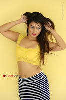 Cute Telugu Actress Shunaya Solanki High Definition Spicy Pos in Yellow Top and Skirt  0490.JPG