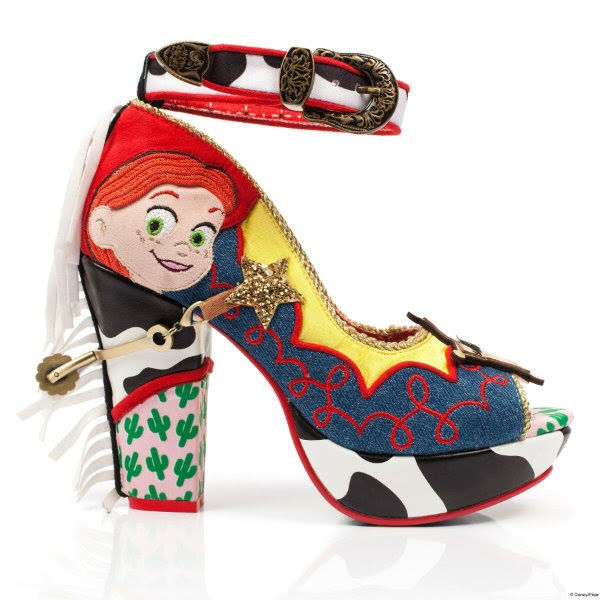 side profile of single shoe in denim, cow and cactus print with yellow and red trim and cowgirl applique face with stirrups on back of shoe