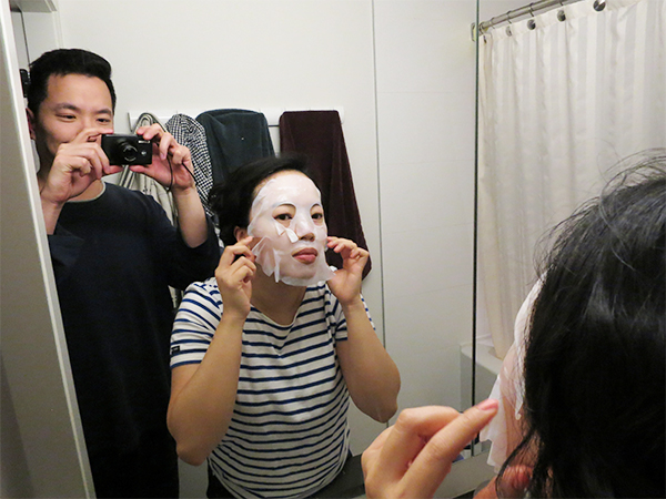 Applying a For Beloved One Melasleep Whitening Bio-Cellulose Mask in the bathroom at home