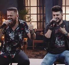 Zé Neto e Cristiano no clipe de Estado Decadente