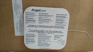 Angelcare Sensor pad laying on wooden base of cot