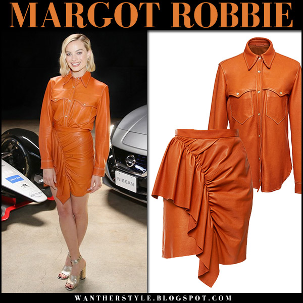 Margot Robbie in orange leather shirt and mini skirt isabel marant nela event fashion april 16