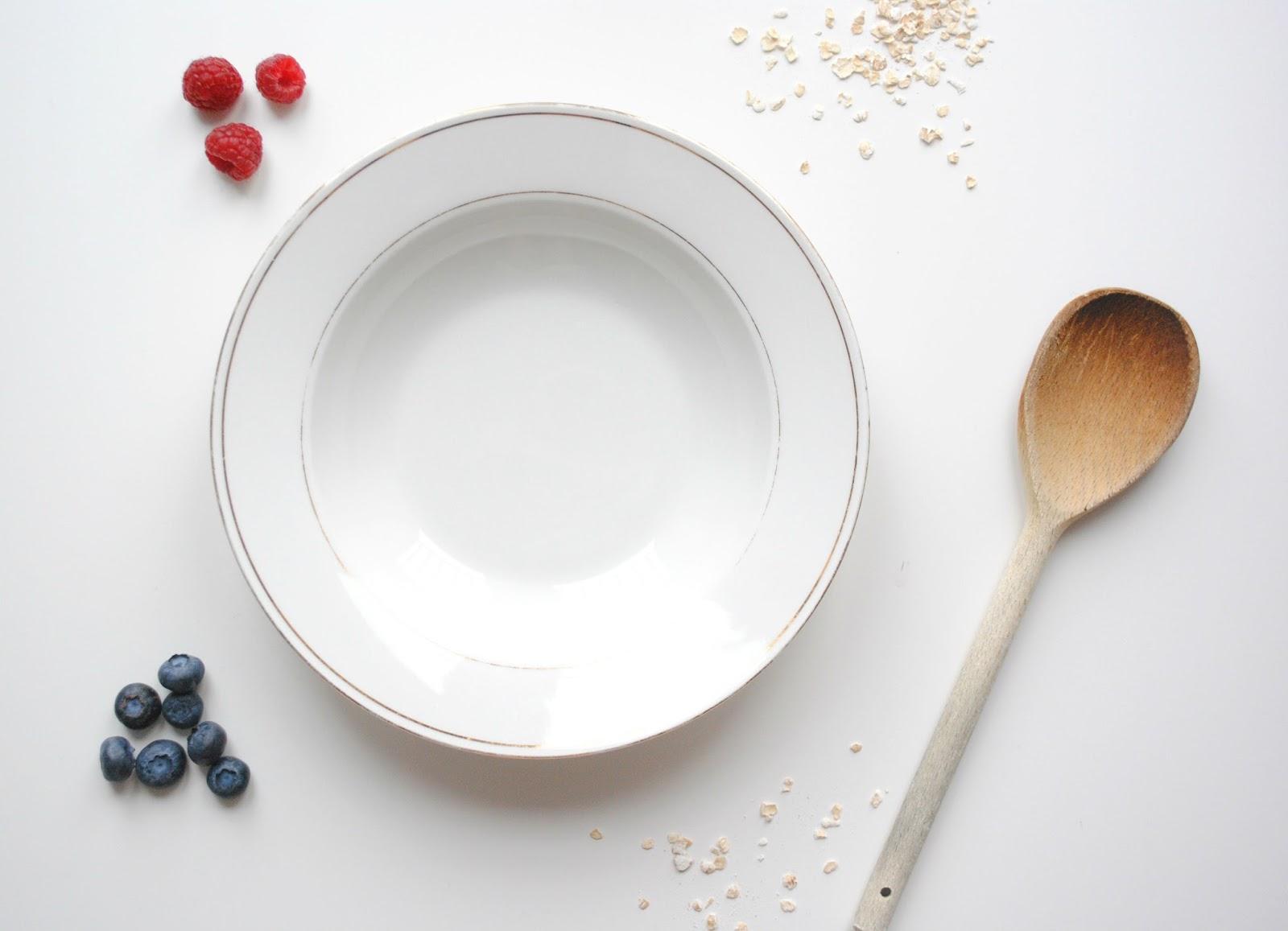 porridge bowl fresh breakfast healthy raspberries blueberries wooden spoon food preparation fruit