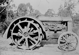 old black and white photograph of a farm tractor
