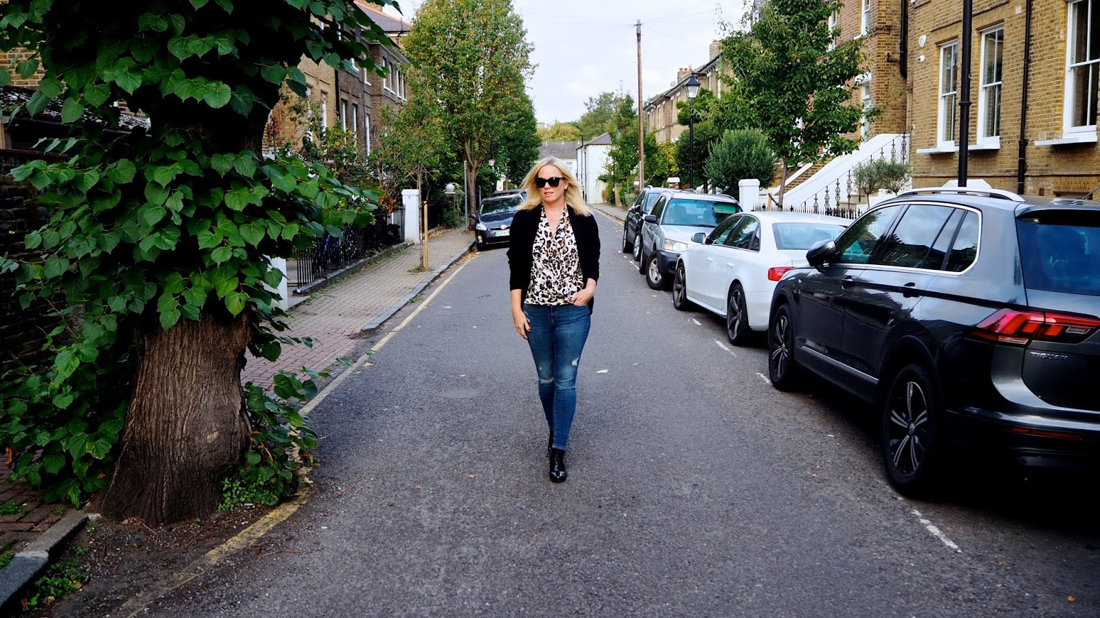 leopard print top and jeans