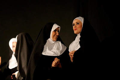 Two nuns in The Old Button Costumes excitedly talking to each other