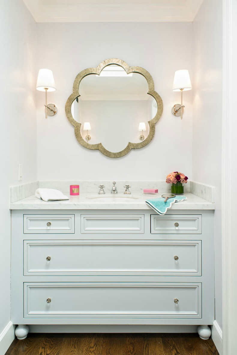 coastal light blue painted modern cabinet as vanity and large shaped mirror