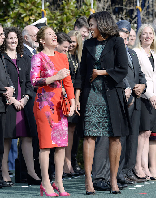Two women in dresses laughing