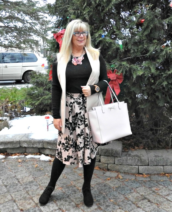 Blush floral skirt and vest with a yosa necklace, jord watch and kate spade bag