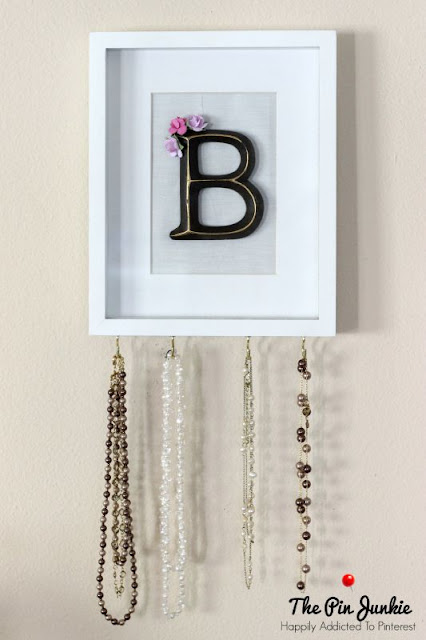 Keep necklaces organized with this easy to make monogrammed jewelry organizer. Would make a great gift.