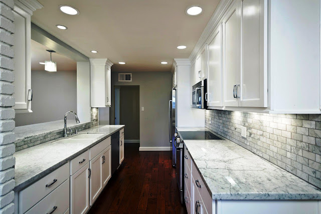 majestic white granite with white cabinets