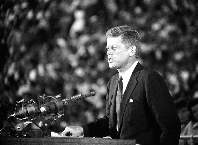 On July 15, 1960, Senator John F. Kennedy tells Democratic convention delegates and some 65,000 others in the Los Angeles Coliseum that he will be the party's candidate for President in the 1960 campaign.