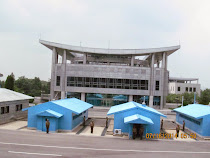 South Korean House of Freedom and blue armistice and military commission huts, DMZ from North Korea