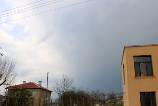 The storm blows in, though blue sky is still above