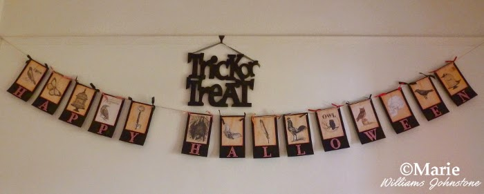 Trick or treat wall decoration in black with handmade garland bunting underneath