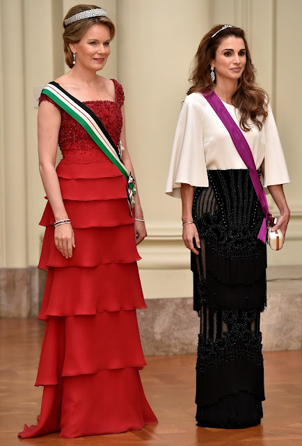 Queen Mathilde and Queen Rania attends a gala dinner at the Laeken royal Palace in Brussels. Queen Rania wore Valentino Gown, Queen Mathilde wore red gown. Queen Mathilde Tiara, Queen Rania diamond tiara