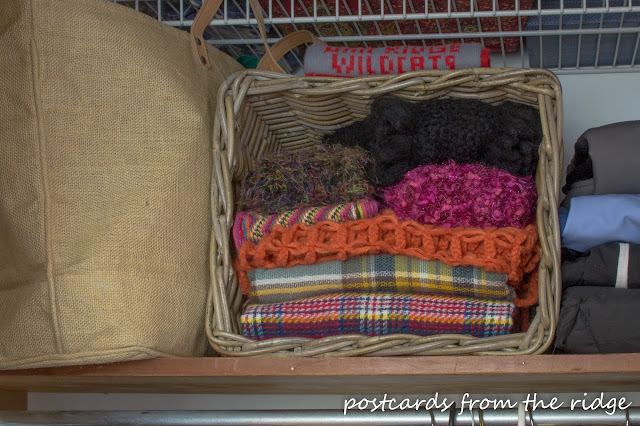 Coat Closet Organization - scarves in a basket. Lots of great ideas here.