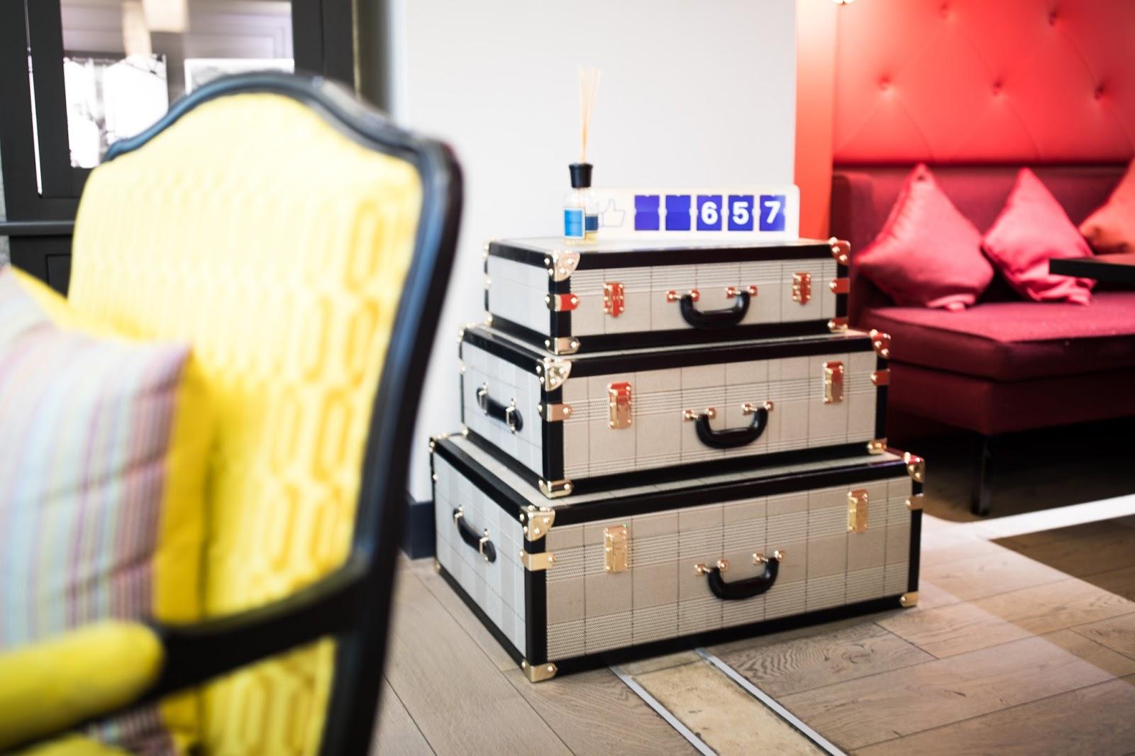 hotel gustave paris lobby suitcases