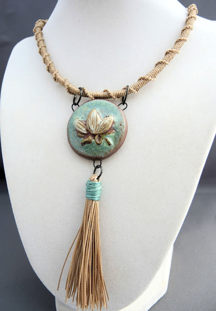 Necklace by Sherri Stokey featuring macrame strap, artisan pendant and tassel.