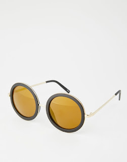 http://www.asos.com/Monki/Monki-70s-Tortise-Shell-Round-Retro-Sunglasses/Prod/pgeproduct.aspx?iid=6338293&cid=7662&sh=0&pge=0&pgesize=36&sort=-1&clr=Black&totalstyles=928&gridsize=3