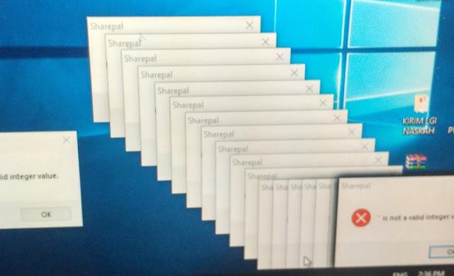 Tampilan monitor yang terkena virus Sharepal