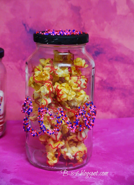 Chocolate-covered popcorn, sprinkles